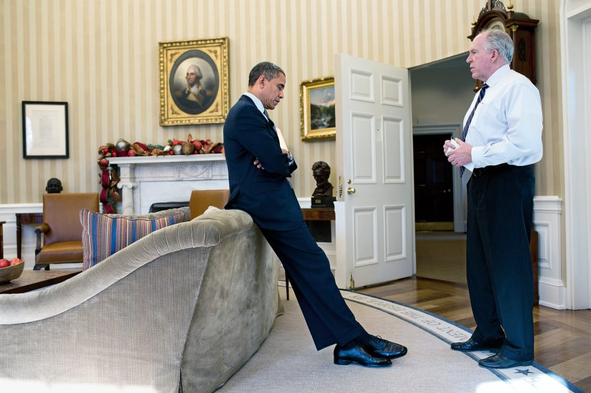 Obama learns of the Sandy Hook Elementary School shooting from Homeland Security Adviser John Brennan on Dec. 14, 2012.