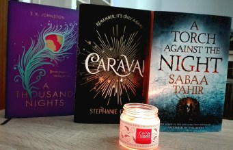 A thousand nights caraval and a torch against the night