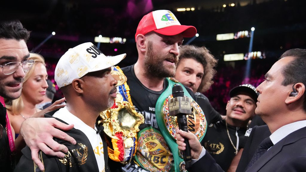 """""""Tyson Fury (center) is a better fighter because he wants to learn and I want to teach,"""" said trainer Javan """"Sugar"""" Hill Steward (left) following Fury's 11th-round knockout of Deontay Wilder on Oct. 9 in defense of his WBC heavyweight title. (Sean Michael Ham/TGB Promotions)"""