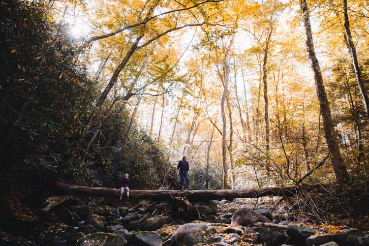 Two people in Cherokee National Forest with fall colors in the background.