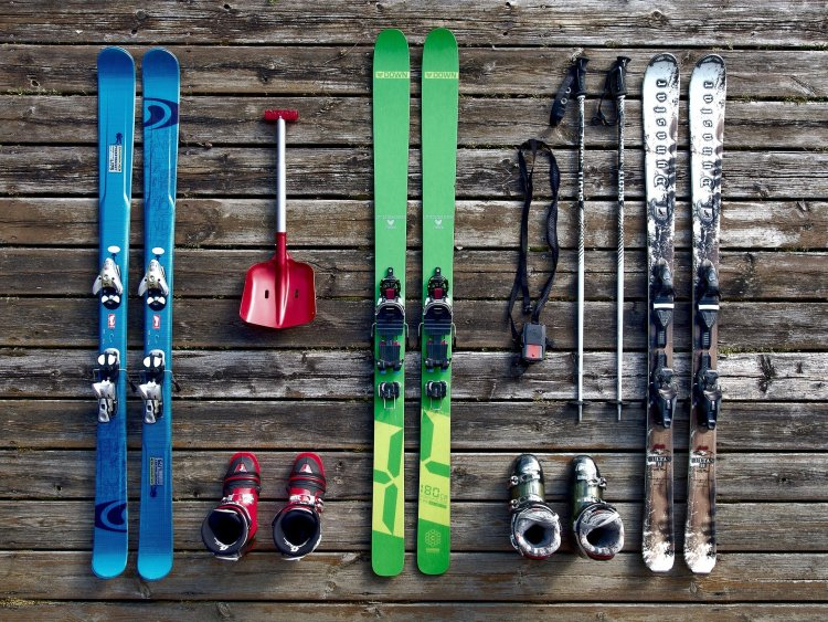 Ski equipment lying on a wooden porch