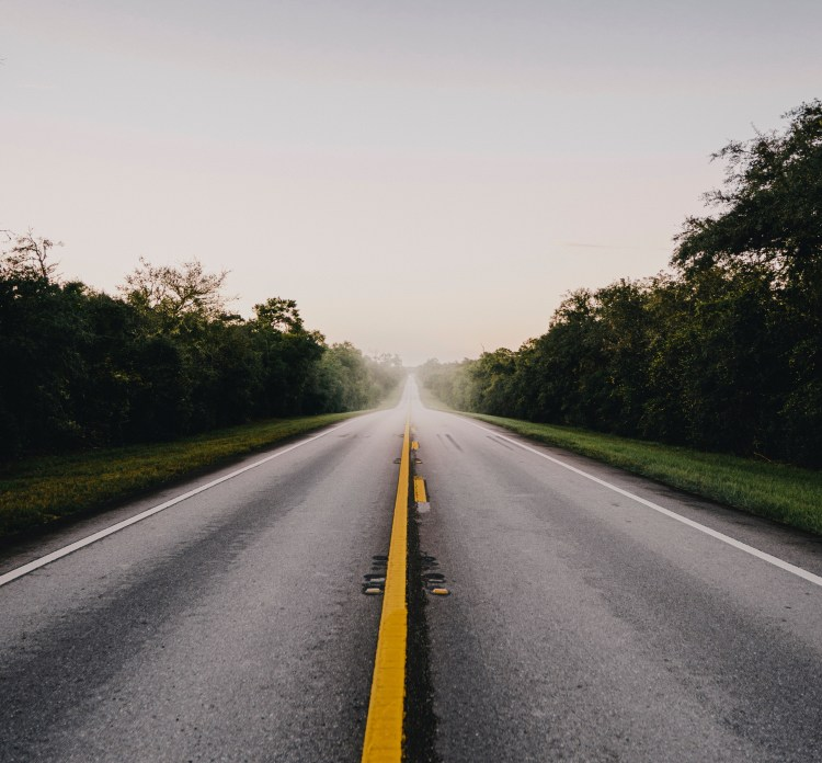 A straight road disappears into the horizon