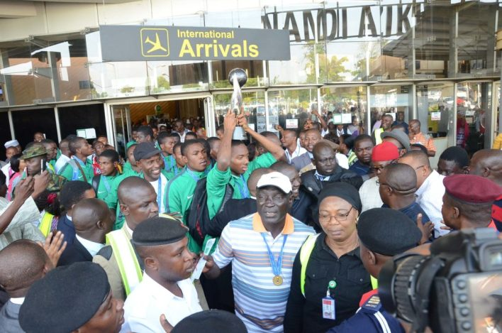 Eaglets Captain Kelechi Nwakali (middle) and his team mate in the midst of the crowd on arrival at Nnamdi Azikiwe International Airport in Abuja on Wednesday