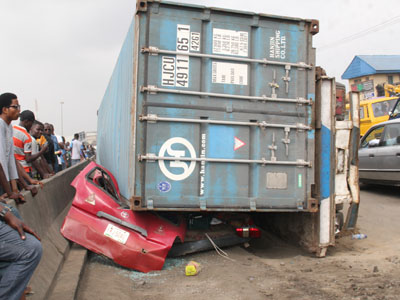 Image result for Container falls off truck in Lagos, crushes driver to death [Photos]