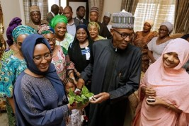 Image result for Aisha Buhari renews love with President, presents hubby with Gardenias flowers