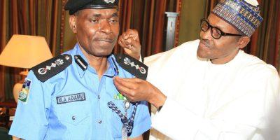 Photos: Buhari decorates new IGP Adamu
