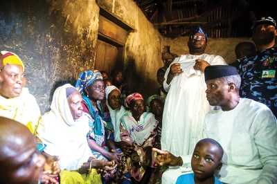 •SPARING A THOUGHT FOR THE POOR: Prof. Osinbajo (right) discussing with a family in Saki town, Oyo State...at the weekend. With him is APC governorship candidate Adebayo Adelabu.