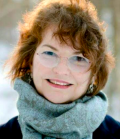 Headshot of Barbara Diehl Peirce in green scarf with snow in background
