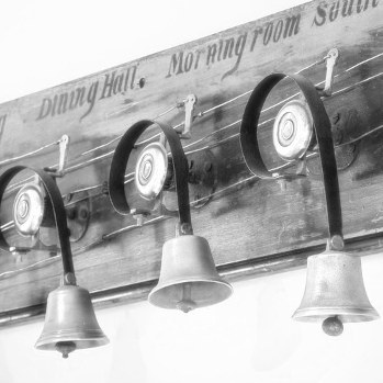 Brass servants' bells mounted on a wall