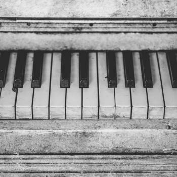 Old piano keyboard in black and white