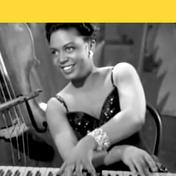 Hazel Scott at the piano with bass in background