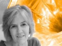Carol Krauss B/W portrait against orange phonograph horn