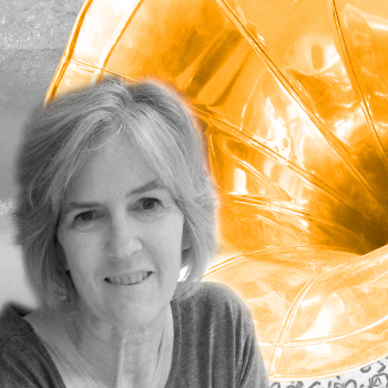 Carol Krauss B/W portrait against orange phonograph horn