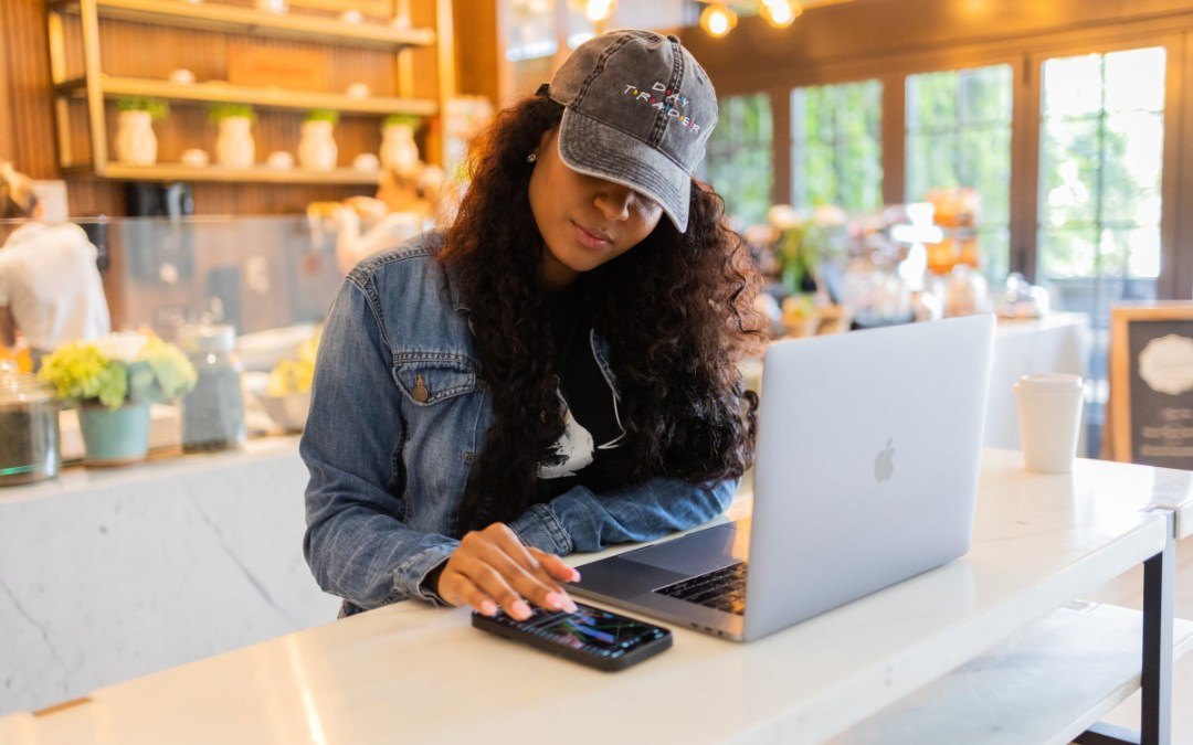 woman with laptop and cell phone