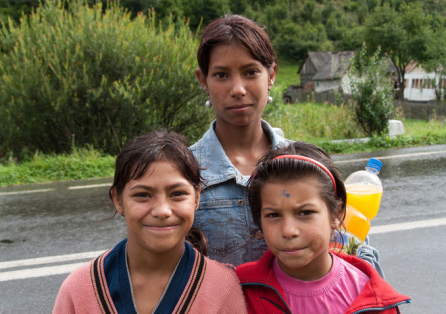 Picture: A group of an older Romani woman and two Romani girls