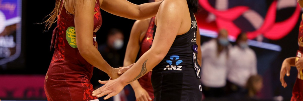 Vitality Roses player Geva Mentor shakes hands with Silver Ferns player Tiana Metuararu after game one of the Cadbury Netball Series between the New Zealand Silver Ferns and England Vitality Roses at Christchurch Arena on September 20, 2021 in Christchurch, New Zealand. (Photo by Peter Meecham/Getty Images)