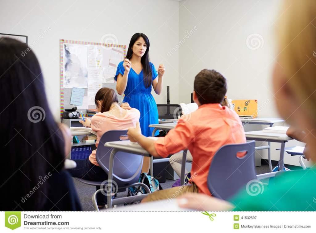 female-high-school-teacher-taking-class-pupils-sit-table-41532597