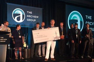 tokken winner holding award