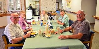Seniors enjoying their meals together at an assisted living community