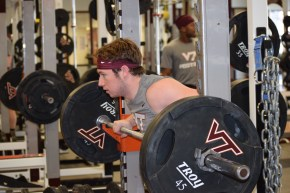 Blacksburg, Va., Sept. 6- WATCHFUL EYES: C.J. Carroll watches on as his teammates complete their sets of benchpress for the day. Photo: Blayne Fink