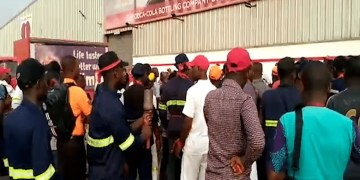 workers-of-coco-cola-ghana-protest-against-removal-of-md