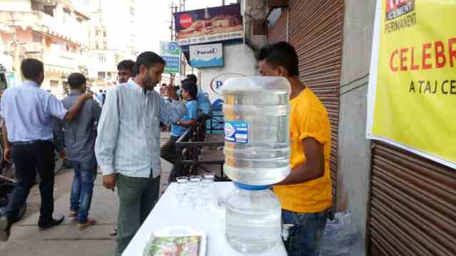 Water booths set up by Taj Cement for helping the people in queues