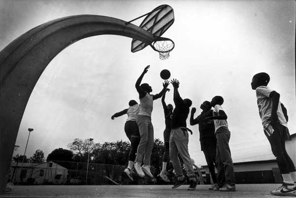 Young men and boys play basketball outside the Carver YMCA on April 9, 1984. (Courtesy of HistoryMiami, Miami News collection)
