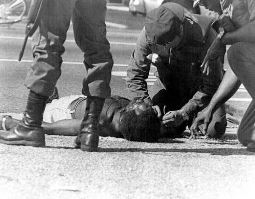 A victim hurt during the McDuffie riots laying on the floor. (Credit: State Archives of Florida)