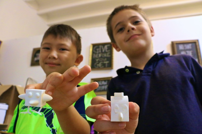 Wynwood Maker Camp students show off their 3D prints. (Wynwood Maker Camp photos)