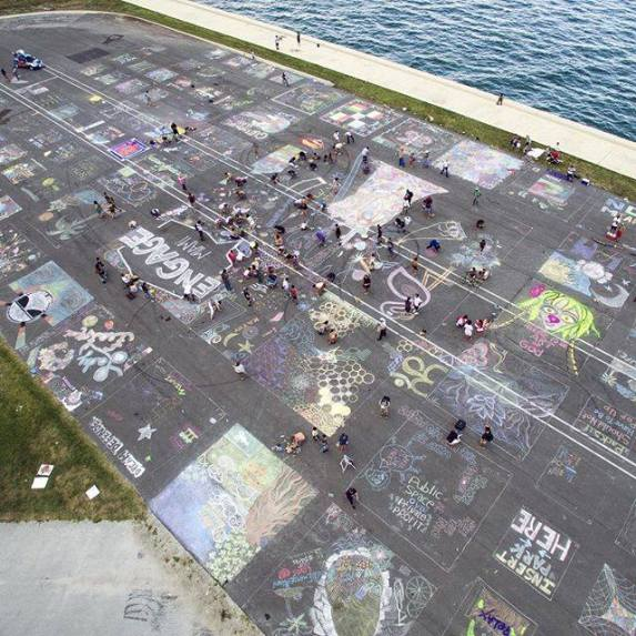 Chalking away at Engage Miami's Dan Paul Park protest. (Courtesy of Dark Matter Collective)