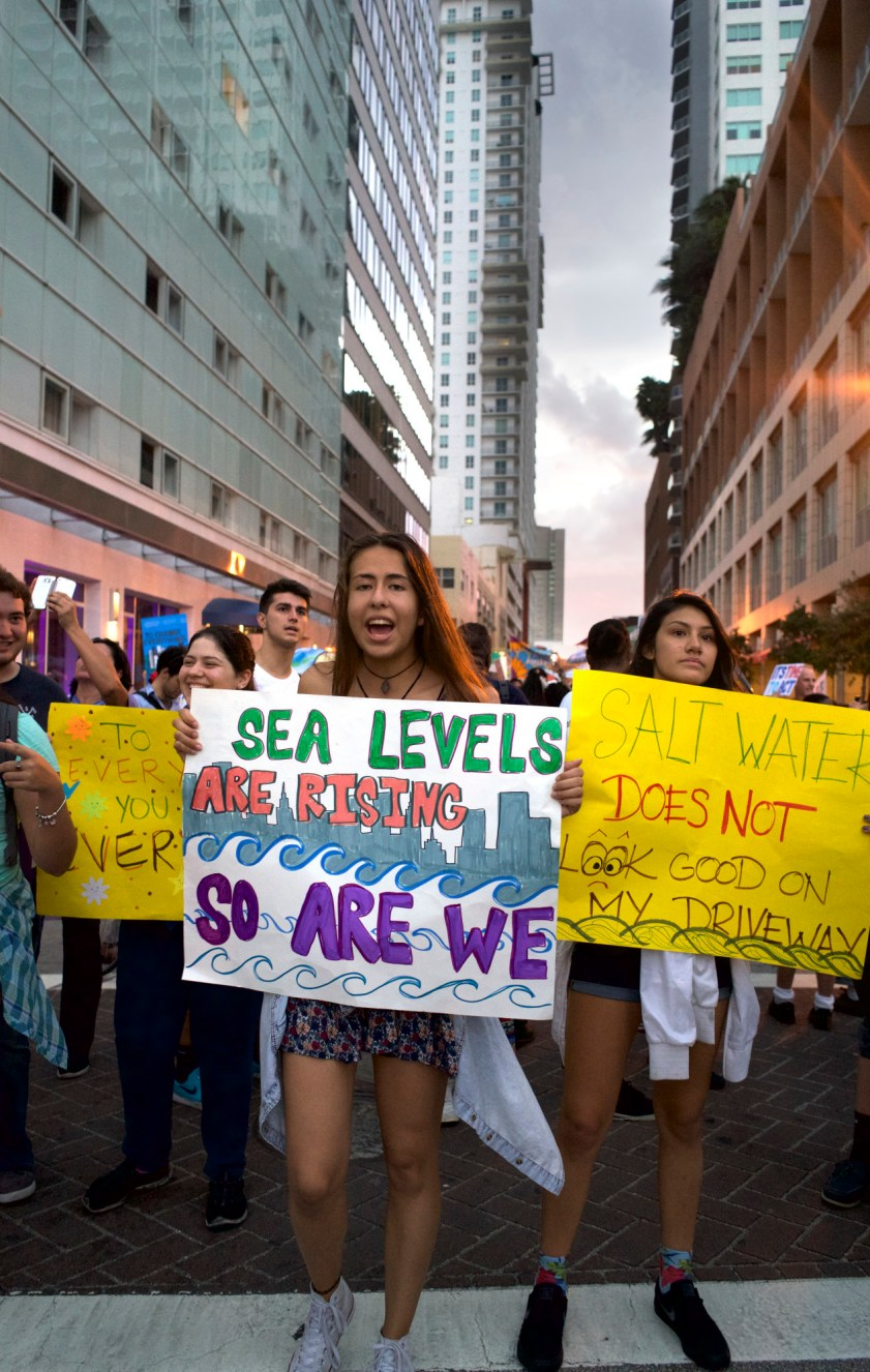 Protestors march at a climate change rally in Downtown Miami.