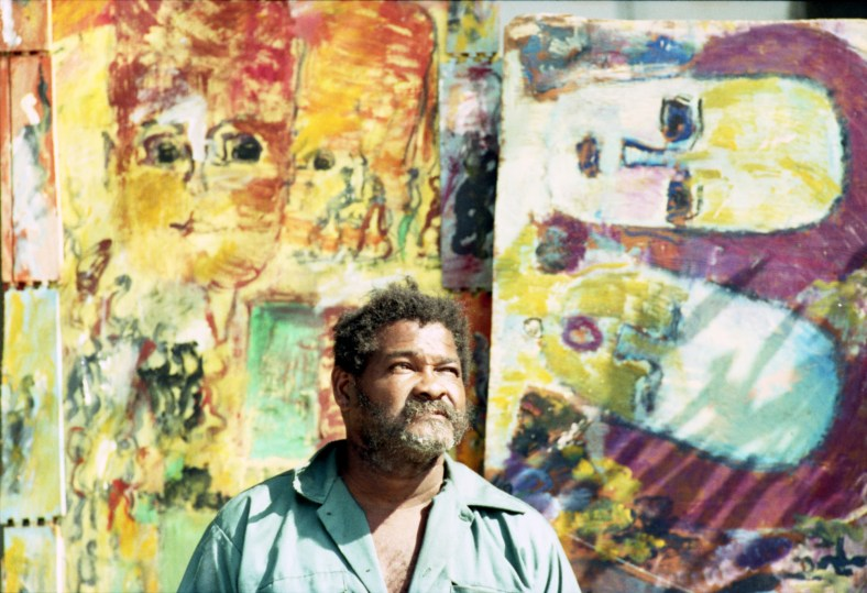 Artist Purvis Young outside his house in Overtown. in 1993. Patrick Farrell, photographer. Miami Herald Collection (Courtesy of HistoryMiami Museum)