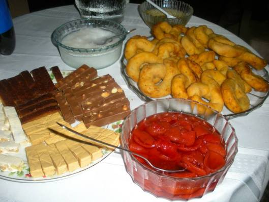 Cuban holiday desserts, including Spanish turrones of all different flavors, guava pieces soaked in a sugar syrup, and buñuelos which can be accompanied with sugar syrup with anise on top or sweet shredded coconut. (Courtesy of Stefanie Delgado)