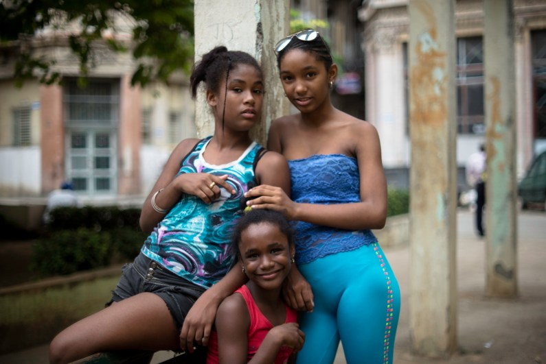 A group of best friends in a city park in Havana.