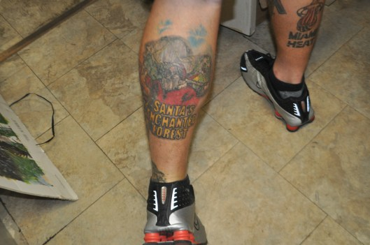 A tattoo of Santa's Enchanted Forest on Cormican's calf.