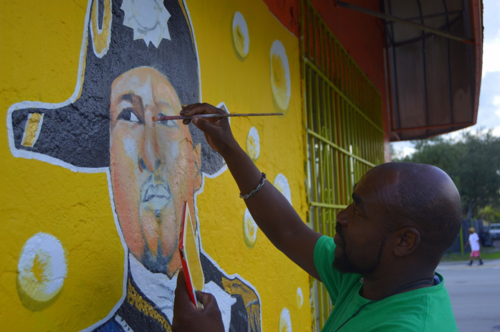 Little Haiti artist Serge Toussaint creating one of iconic murals. (Courtesy Alain Pierre-Louis)