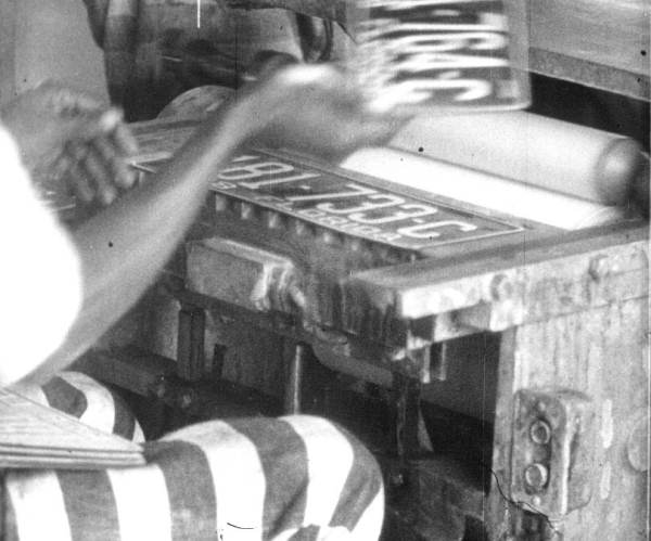 Florida prison inmate making license plates in 1928. (Courtesy of State Archives of Florida, Florida Memory.)