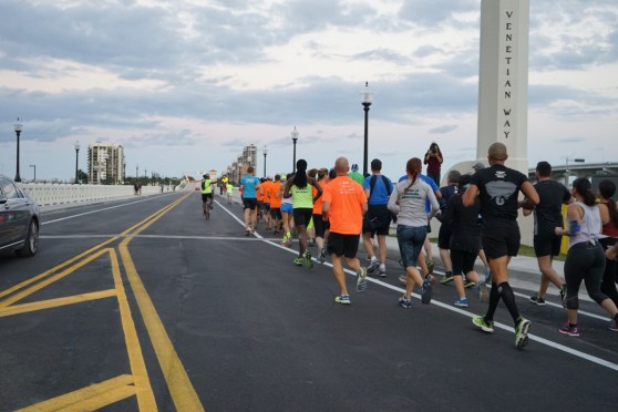 Runners crossing the beloved bridge.