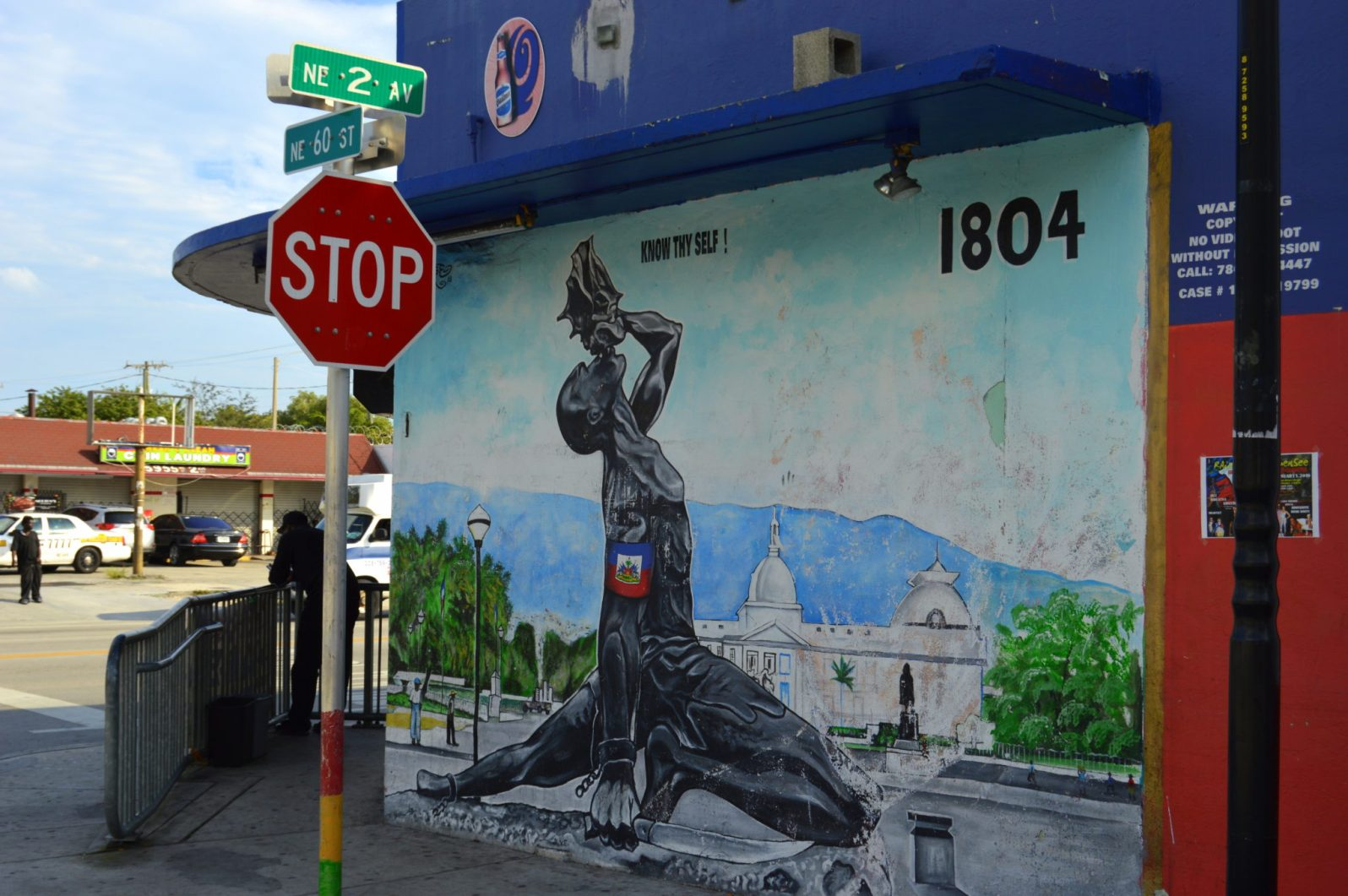 This mural by Toussaint depicts a statue in Haiti of a slave sounding the beginning of the revolution by blowing a conch shell and breaking the chains of oppression.