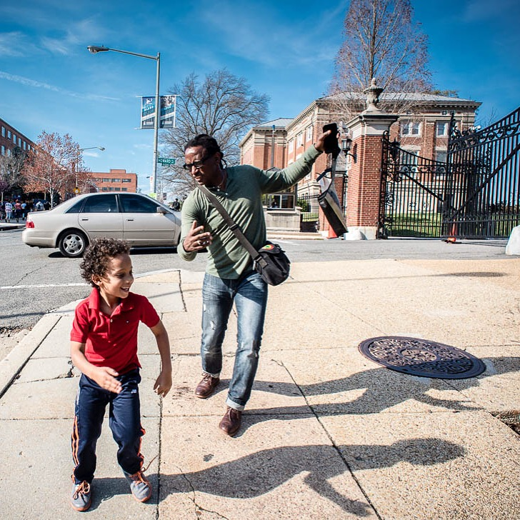 Juste and his son Miles on the Howard University campus. Juste took his son to Howard, a historically black university, in part to show him other colleges and to continually instill the importance of his blackness within him. (Photo courtesy of Carl Juste)