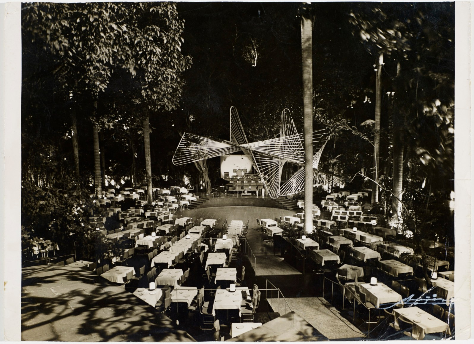 View of outdoor seating at Tropicana's Bajo las Estrellas (Under the Stars) cabaret, c. 1955 Vicente Muñiz (Cuban, 1917–2007) (Courtesy of The Wolfsonian–FIU, The Vicki Gold Levi Collection)