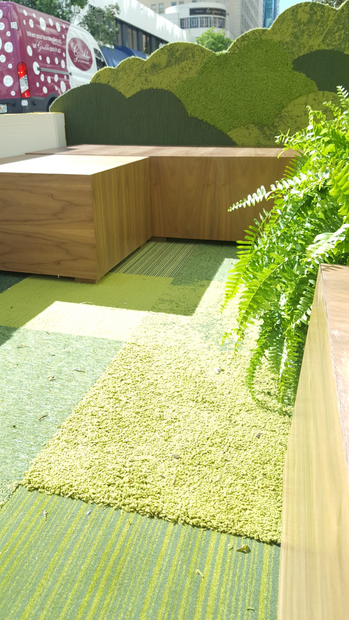 The carpeting company, FLOR, designed this parklet in Downtown Miami for PARK(ing) Day. Courtesy of Isabella Bru)