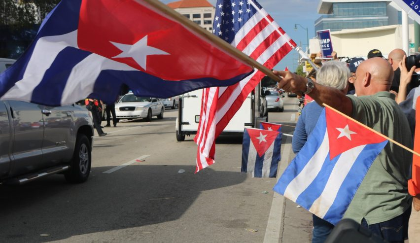Flags waved on Calle Ocho through Saturday morning. (Credit: Alexandra Martinez/The New Tropic)