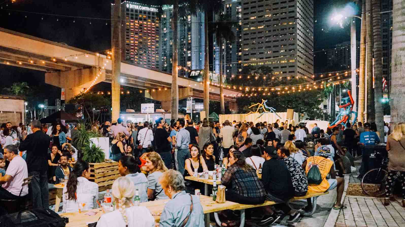 A crowd sitting at Biscayne Green. (Credit: Bruce Pinchbeck/The New Tropic)