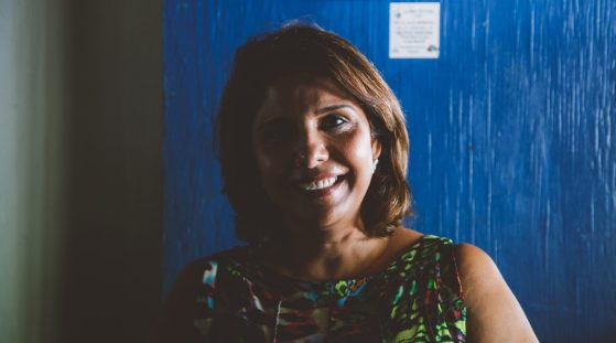 """Jina Balani, local business owner / I've been here for 30 years. I came here when I got married at 19. It's grown in the last 30 years, but we still enjoy the beaches and the nature. I'm a yoga teacher, so that's what keeps me in Curaçao. I like the beaches, and although I don't go hiking in the mountains, I like them. All three of my sons were born here — the older one went to Africa and to Hong Kong to work, but he came back. I guess Curaçao just pulls you back. My second son went to Holland to study but said, """"the beach is my life and came back."""" The third is studying in America. On the weekends I like to form a group of friends and go out to Riffort Village or go to Pietermaai district. I think I'll retire here. It's a very laid-back kind of life. My sisters and family live in Hong Kong and they've been asking me to come, but I can't live that fast life. Life is laid back here and I enjoy it."""