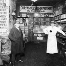 Another Jewish shop keeper offering his goods, seen posing here for the camera.