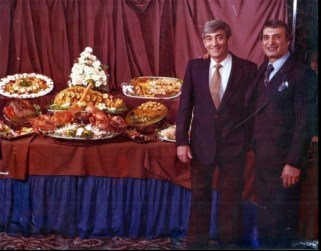 Tommy and mgr. Joe Black with food display at The Manor East Caterers