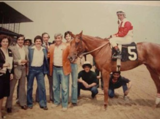 "Tommy in the ""Winners Circle"" with one his horses"