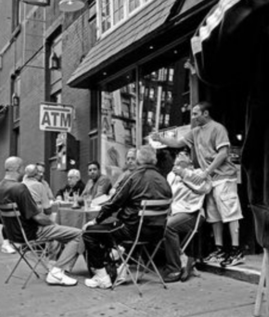 Knockaround, neighborhood guys sitting outside on folding chairs in front of a Little Italy social club. A very typical street scene on Mulberry Street. Note the tracksuits and sneakers...these fellas don't look like 9 to 5'ers if you ask me. Lol