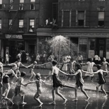 1940s-1950s East Harlem - typical scene that played out every day on any given Harlem street. Neighborhood kids playing in the sweltering heat, saved by the Johnny pump. It seems they got fancy here any actually created a spray of cold water for fun.